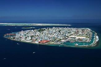 При взгляде наМале, столицу Мальдив, ни укого неповернётся язык назвать опасающихся повышения уровня моря паникёрами