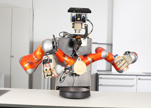 Робот готовит блинчики.