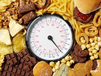 Неконтролируемое потребление пищи, по мнению учёных, может быть попыткой восполнить дефицит дофамина.