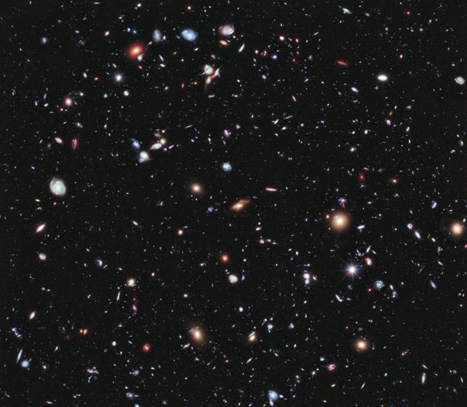 Рисунок 1. Результат глубокого обзора «Хаббла» (Hubble): 3000 галактик вкрошечной области неба.