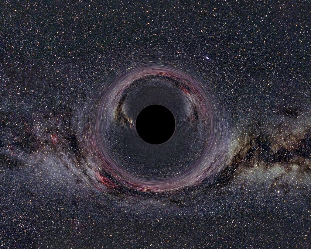 Визуализировать чёрную дыру очень сложно. Так художники представляют себе массивные чёрные дыры.