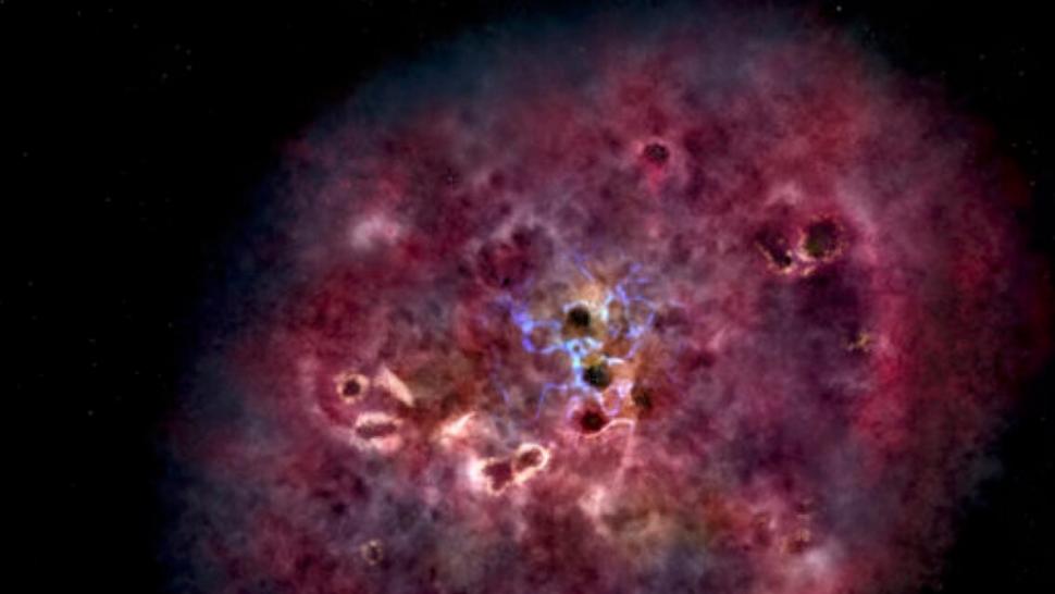 Гигантская сверхактивная галактика образовалась нараннем этапе Вселенной. Она быстро развивалась ивнезапно замерла